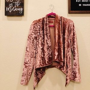 A soft velvet pink swing sweater